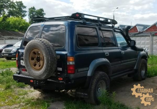 Задний силовой бампер OJ 03.177.02 для Toyota Land Cruiser 80 с универсальной калиткой